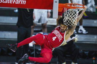 Ohio State's Duane Washington Jr. scores on a dunk during a Friday Big Ten Conference Tournament quarterfinal against Purdue in Indianapolis. (AP Photo)