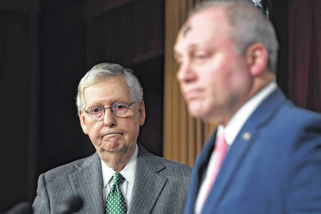 Senate Majority Leader Mitch McConnell of Ky., left, and House Minority Whip Steve Scalise, R-La., are both opposed to H.R. 1, the first bill of the new House majority that tackles campaign finance reforms and other issues.