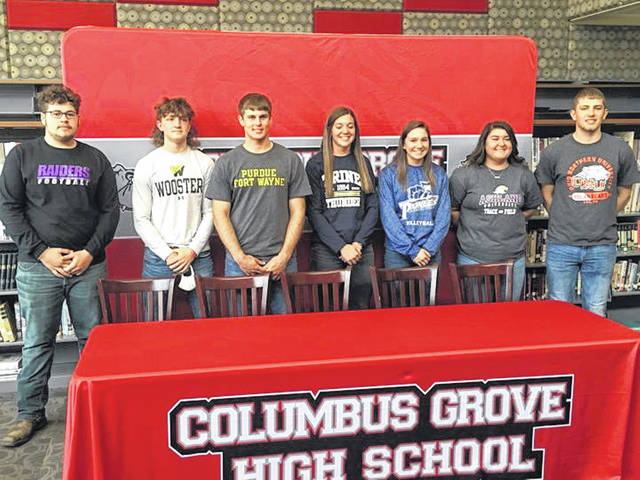 Those signing college letters of intent at Columbus Grove included, from left, Gunner King (football, Mount Union), Jon Banal (football, Wooster), Ethan Halker (track and field, Indiana-Purdue Fort Wayne), Erin Downing (track and cross country, Trine), Alayna Ricker (volleyball, Marietta), Kennedy Flores (track and field, Ashland) and Tayt Birnesser (basketball, Ohio Northern).
