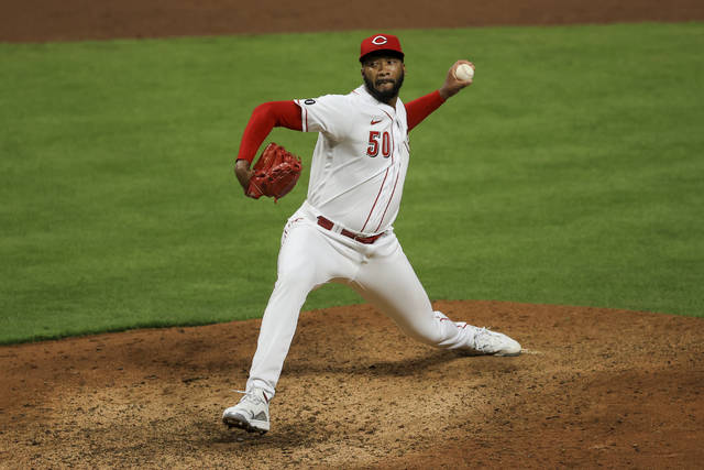 Cincinnati Reds' Amir Garrett throws during the ninth inning of a baseball game against the Pittsburgh Pirates in Cincinnati, Monday, April 5, 2021. (AP Photo/Aaron Doster)