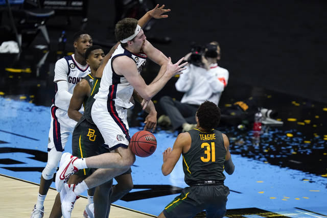 Gonzaga forward Drew Timme loses control of the ball in front of Baylor guard MaCio Teague (31) during the first half of the championship game in the men's Final Four NCAA college basketball tournament, Monday, April 5, 2021, at Lucas Oil Stadium in Indianapolis. (AP Photo/Michael Conroy)