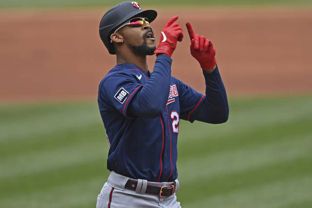 Minnesota Twins' Byron Buxton (25) celebrates after hitting a solo home run off Cleveland Indians starting pitcher Logan Allen in the first inning of a baseball game, Wednesday, April 28, 2021, in Cleveland. (AP Photo/David Dermer)