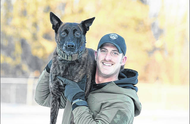 Canton Police Officer Sherman Schilling poses with partner, Diesel.
