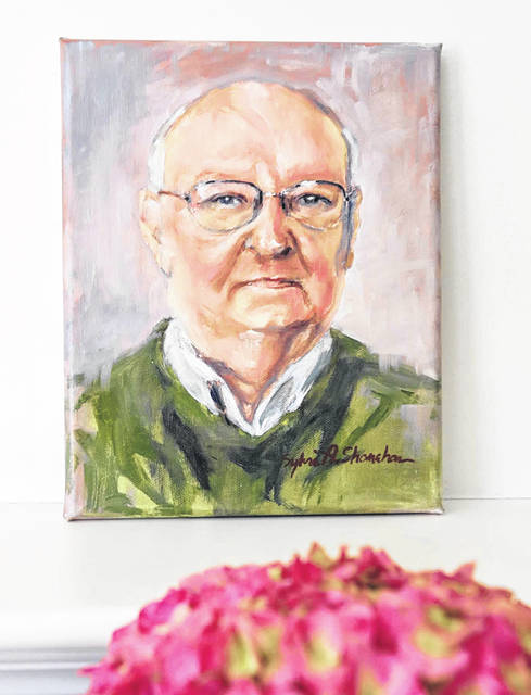 An oil painting of Harold Arnold by artist Sylvia Shanahan is shown as part of the Faces Not Numbers project. Artists provide paintings of those who have died from COVID-19 to their family members at no charge.