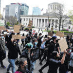 Protesters gather at Statehouse, march down High Street