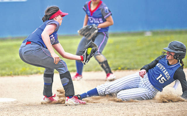 Crestview's Bailey Gregory tags out Allen East's Gracee McKeever during Monday's game at Allen East High School.
