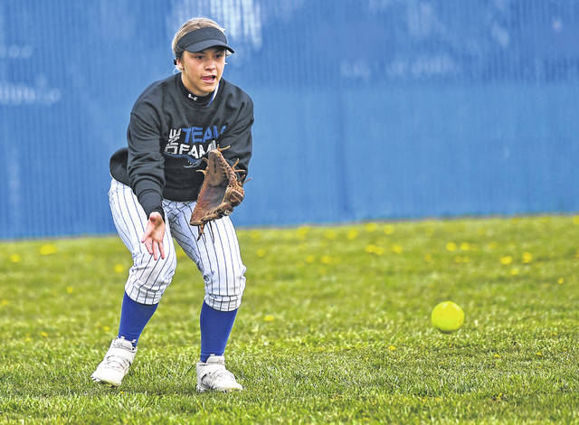 Allen East's Abbie Wireman fields a ball in the outfield against Crestview during Monday's game at Allen East High School.  Richard Parrish | The Lima News