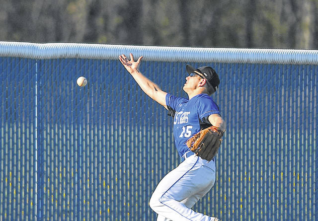 Allen East's Blake Hershberger misplays a fly ball in the outfield against Lincolnview during Monday's game at John W. Fleming Field in Harrod.