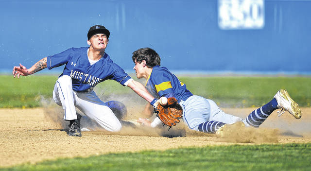 Allen East's Bradden Crumrine attempts to tag out Lincolnview's Collin Overholt during Monday's game at John W. Fleming Field in Harrod.