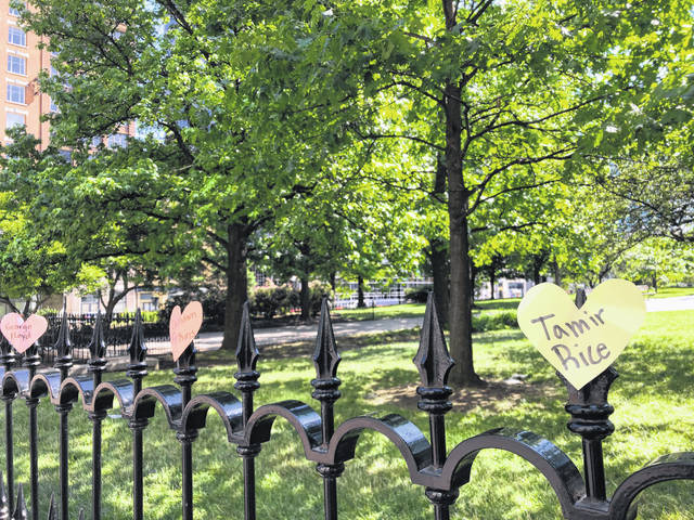 Hearts with the names of black people who died at the hands of police are displayed on a fence June 6, 2020, as part of a protest at the Ohio Statehouse in Columbus.
