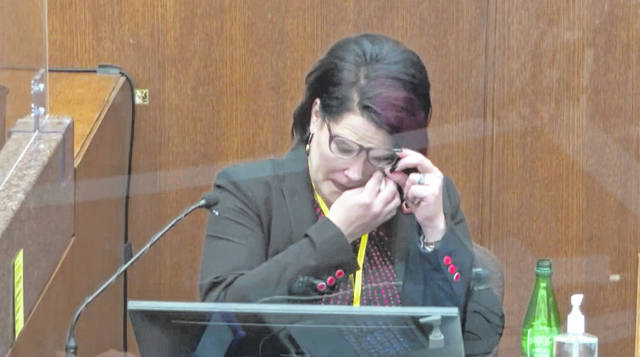 In this image from video, witness Courteney Ross answers questions as Hennepin County Judge Peter Cahill presides Thursday in the trial of former Minneapolis police Officer Derek Chauvin at the Hennepin County Courthouse in Minneapolis, Minn. Chauvin is charged in the May 25, 2020 death of George Floyd.