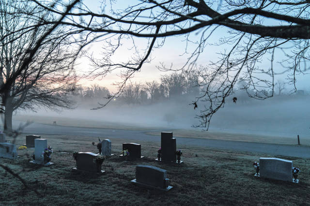 Morning fog blankets a cemetery March 17 in West Virginia. The number of U.S. suicides fell nearly 6% in 2020 amid the coronavirus pandemic — the largest annual decline in at least four decades, according to preliminary government data.