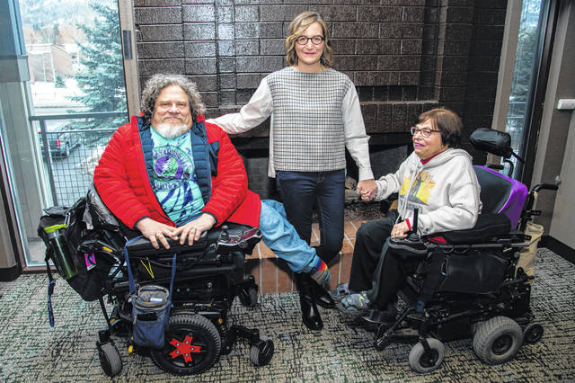 """Co-directors Jim LeBrecht, left, and Nicole Newnham, center, from the documentary """"Crip Camp"""" pose Jan. 24, 2020, with film subject Judith Heumann during the Sundance Film Festival in Park City, Utah. The disabled have a moment in the Oscar spotlight that they hope becomes a movement. LeBrecht, who has spina bifida and uses a wheelchair, says a golden age for disabled films could come if Hollywood lets them tell their own stories."""