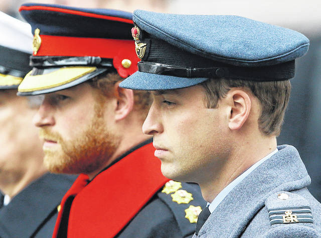 Britain's Prince William, right, and Prince Harry attend the Remembrance Sunday ceremony Nov. 8, 2015, at the Cenotaph in London. Senior royals must wear civilian clothes to Prince Philip's funeral, defusing potential tensions over who would be allowed to don military uniforms. Queen Elizabeth II's decision means Prince Harry won't risk being the only member of the royal family not in uniform during the funeral on Saturday for his grandfather, who died last week at the age of 99.