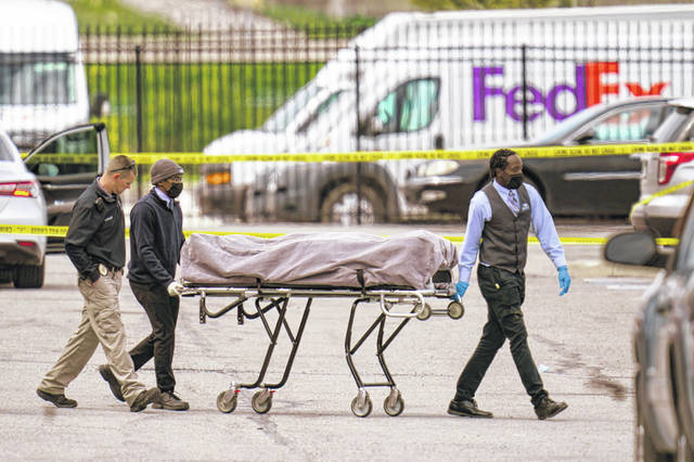 A body is taken from the scene Friday where multiple people were shot at a FedEx Ground facility in Indianapolis. A gunman killed several people and wounded others before taking his own life in a late-night attack Thursday at a FedEx facility near the Indianapolis airport, police said.