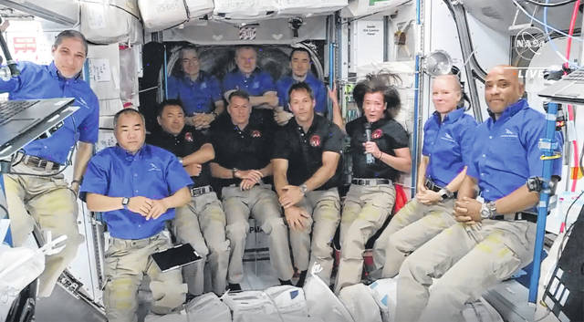 Astronauts from SpaceX join the astronauts of the International Space Station for an interview on Saturday. A recycled SpaceX capsule carrying four astronauts has arrived at the International Space Station, a day after launching from Florida. The Dragon capsule docked autonomously with the orbiting outpost on Saturday.