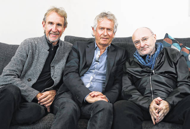 Genesis band members from left, Mike Rutherford, Tony Banks, and Phil Collins pose for a photo March 4, 2020, during an interview in London. The English rock band is returning to the U.S. for their first tour in 14 years. The trio announced The Last Domino? Tour on Thursday, which will kick off in Chicago on Nov. 15.