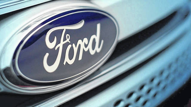 A Ford logo on a 2017 Ford Focus. Ford dealers say new car sales spiked in the first quarter of 2021.