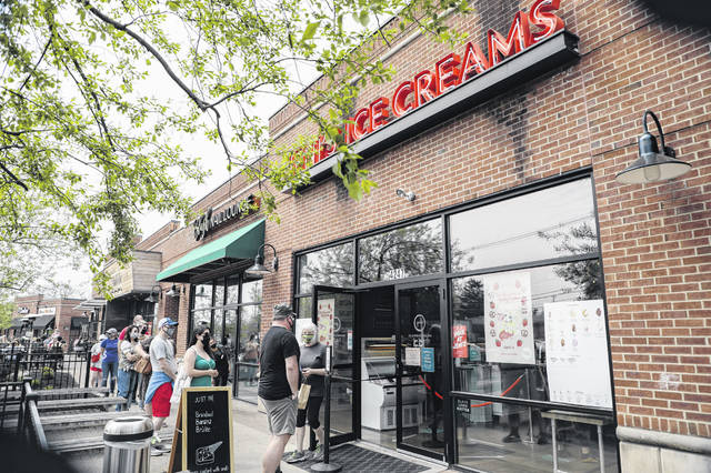 Patrons line up April 8 outside Jeni's Splendid Ice Creams in Columbus for the release of its Strawberry Pretzel Pie ice cream in honor of country music star Dolly Parton.