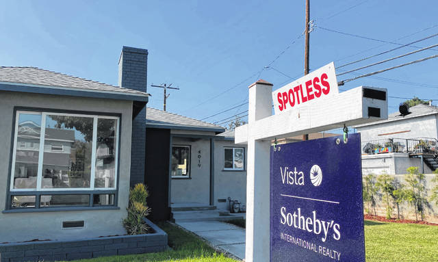 A real estate sign is seen Nov. 19, 2020 in front of a house for sale in West Los Angeles.