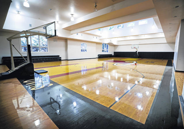 The indoor regulation basketball court in the 31,000 square-foot-home currently owned by NBA legend Shaquille O'Neal.