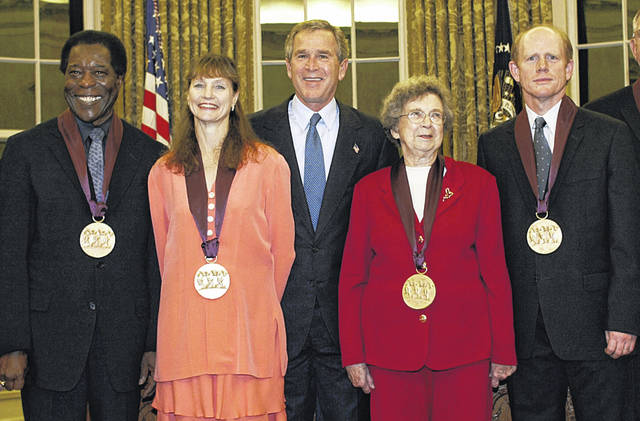 In 2003, then U.S. President George W. Bush (center) stands with recipients of the National Medal of Arts in the Oval Office of the White House. (From left) Blues musician Buddy Guy; dancer and artistic director Suzanne Farrell; Bush; children's book author Beverly Cleary; and actor-director Ron Howard. Cleary has passed away at age 104.