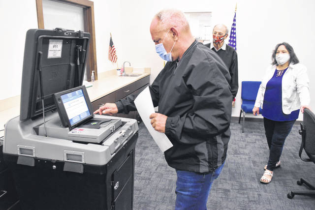 Keith Cheney, president of the Allen County Election Board, on Monday took part in a test of one of the county's election machines that will be in use during the May 5 election. Due to an anticipated low voter turnout — likely less than 20% of registered voters will cast ballots that day, Director Kathy Meyer predicted — just one machine will be placed in each of the county's 35 precincts on election day. Looking on are board members Mona Willamowski and Gary Frueh.