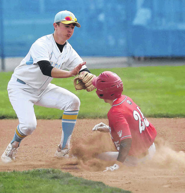 Bath's Joel Rasor tags out Delphos Jefferson's Josh Wiseman at second base during Saturday's game at Bath.