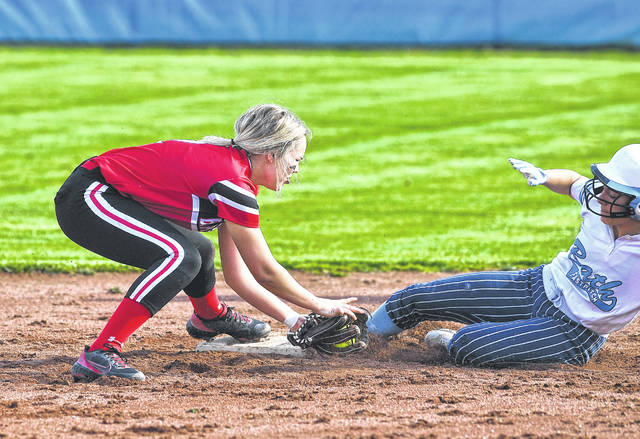 Bath's Abbie Dackin slides under the tag attempt of Spencerville's Jaelyn Boop during Monday's game at Bath High School.