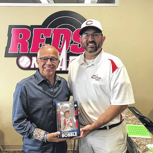 Jay McCollum presents Marty Brennaman, the retired Reds longtime radio announcer, with a Wally Post bobblehead in 2019. McCollum, alongside Lowell Bower and in conjunction with Marty and his wife Amanda is in the process of making a custom Brennaman bobblehead.