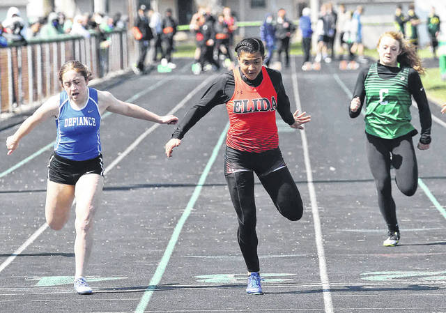 Elida's Analei Jackson, center, finishes ahead of Defiance's Kaitlyn Parrish, left, and Celina's Paige Veit in the 100 meter dash during Saturday's Celina Invitational. Head to LimaScores.com for more invitational photos.