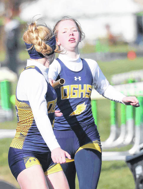 Ottawa-Glandorf's Olivia Fenbert reaches out to hand the baton to Madelyn Hovest during the Celina Invitational 3,200 meter relay Saturday.