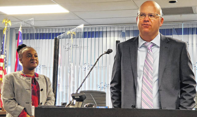 """Shane Coleman, right, executive director of the Lima-Allen County Regional Planning Commission, speaks about the """"Vision 2040"""" initiative for Lima while Lima Chief of Staff Sharetta Smith listens Wednesday at a press conference in Lima's municipal building."""