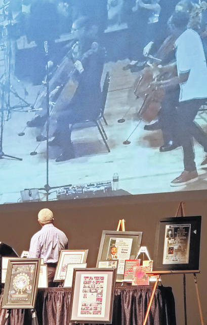 Jessie Pope, bottom left, the honorary commitee chairman for the Community Enrichment Dinner, watches a video of a performance by Black Violin during an event Tuesday at Veterans Memorial Civic Center to announce the 2021 dinner's plans.
