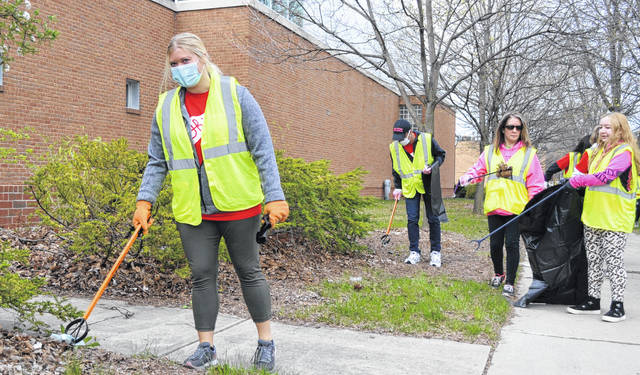 Sara Zalar, 21, of Delphos, helped pick up trash Saturday as part of an effort by Ohio State University at Lima students.