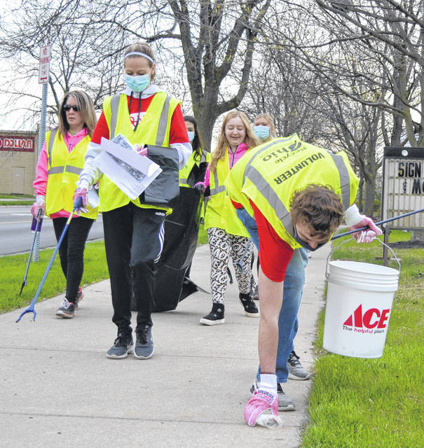 Dozens of volunteers helped clean up downtown Lima on Saturday.