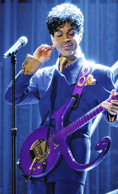 """Prince performs """"Purple Rain"""" at the 46th Annual Grammy Awards on Feb. 8, 2004, at Staples Center in Los Angeles."""