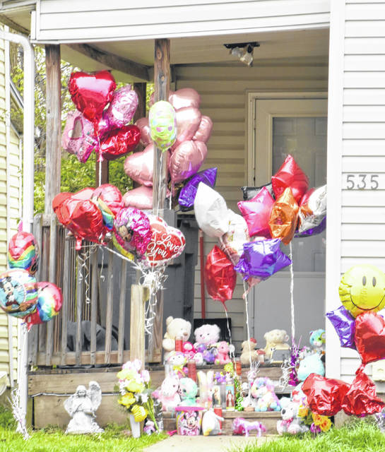 A shrine has been erected for 4-year-old My'Laya Dewitt outside the home on North Elizabeth Street in Lima where she was found unresponsive last week. Romiere Hale has been charged with murder in her death, and her mother faces a child endangerment charge.