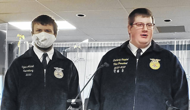 Zachary Zwiebel, right, speaks about a Lima Senior FFA project to repair lawnmowers Wednesday, while Tyler Arheit listens.