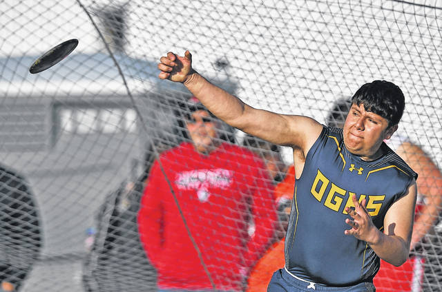 Ottawa-Glandorf's Fernando Valle competes in the discus during Friday night's Ottawa-Glandorf Gold Medal Meet. See more meet photos at LimaScores.com.