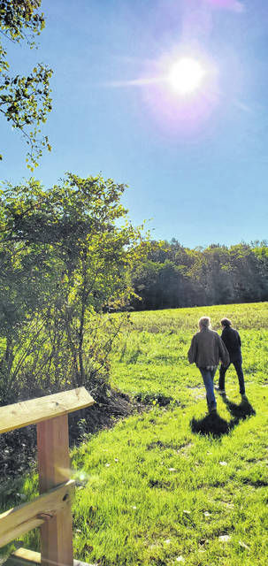 David Trinko | The Lima News A pair of hikers walk a path at Haver's Ridge in September. A hike at the park is planned Saturday at 8:30 a.m. and 10 a.m.