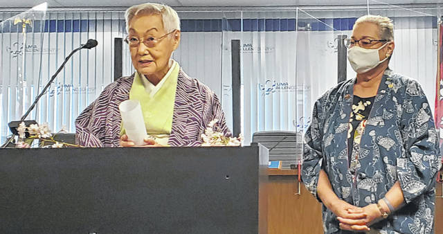Keiko Hahn, left, speaks about Lima's connections to Harima-Cho, Japan, while Sandra Leichty listens Wednesday.