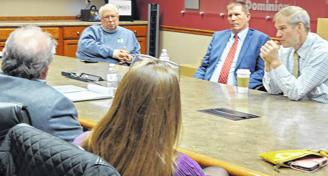 U.S. Rep. Jim Jordan, R-Urbana, right, listens to a business owner's concern during a roundtable Thursday at the Lima/Allen County Chamber of Commerce in downtown Lima.