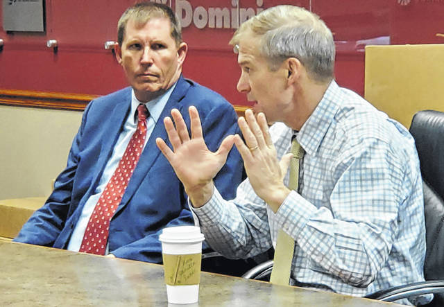 U.S. Rep. Jim Jordan, R-Urbana, right, speaks to business owners while Joe Patton, executive director of OhioMeansJobs Allen County/Job and Family Services, listens during a business roundtable Thursday.