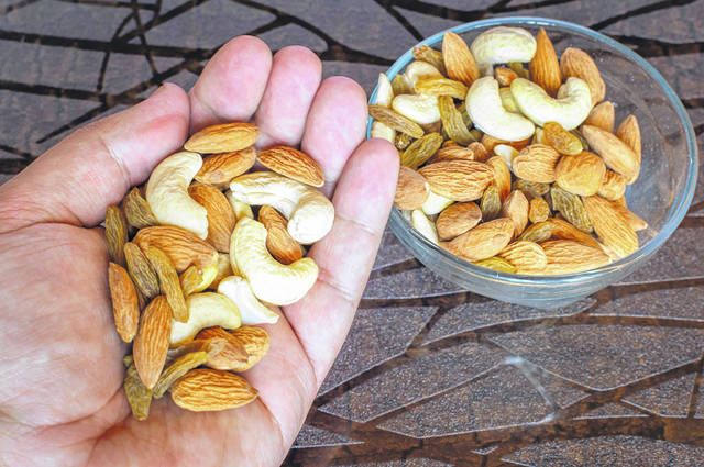 Just 4 measly tablespoons (1/4 cup ) of nuts contains 170 calories. That's reasonable for a snack. But a whole cup — mindlessly ingested — is a whopping 680 calories; enough to qualify for a hefty meal.