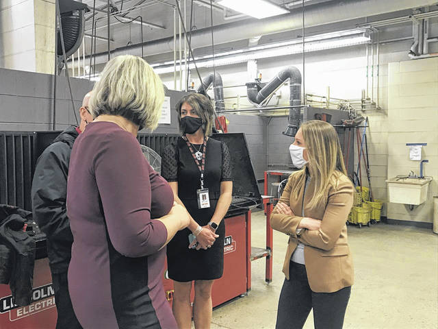 Ohio Rep. Susan Manchester, R-Waynesfield, talks with Apollo Career Center instructors and staff during a tour of the school's welding lab on Monday. Manchester and Rep. Jon Cross visited the school to discuss Ohio's TechCred program and other issues affecting the vocational schools.