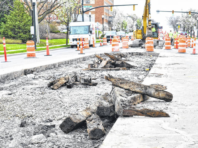 Workers on the Market Street project were surprised Thursday when they dug into railroad ties from the electric street car era in Lima.