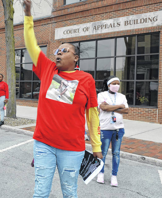 Joeann Brown raises her arm in protest Saturday. She wants justice for the shooting death of her 16-year-old son Mekhi Williams who killed on Nov. 18. A grand jury failed to indict the shooter in the case, citing self-defense.