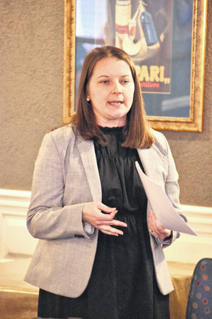 Sarah Newland, newly-appointed executive director of the Allen County Children Services agency, shared with members of the Kiwanis Club of Lima details of the agency's Ohio Start program, designed to assist families where parental drug addiction is present.