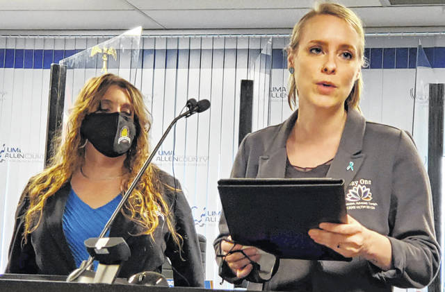 Ryn Farmer, left, of Crime Victim Services, talks about Sexual Assault Awareness Month while Pamela Silver listens Wednesday at Lima Mayor David Berger's weekly press conference.
